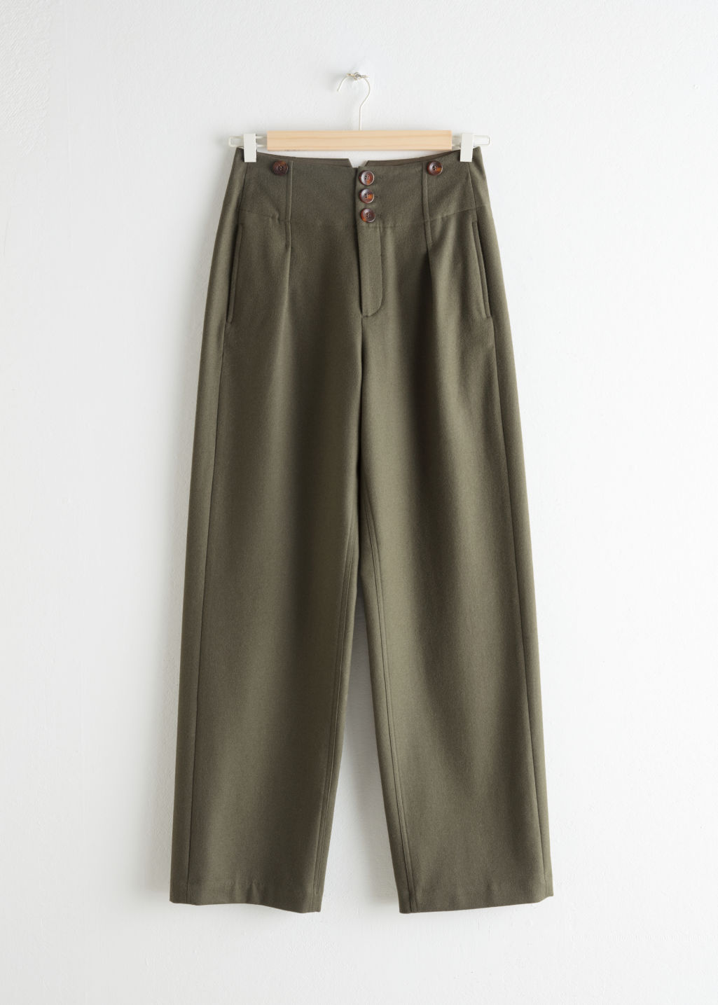 Front image of Stories wool blend workwear trousers in green