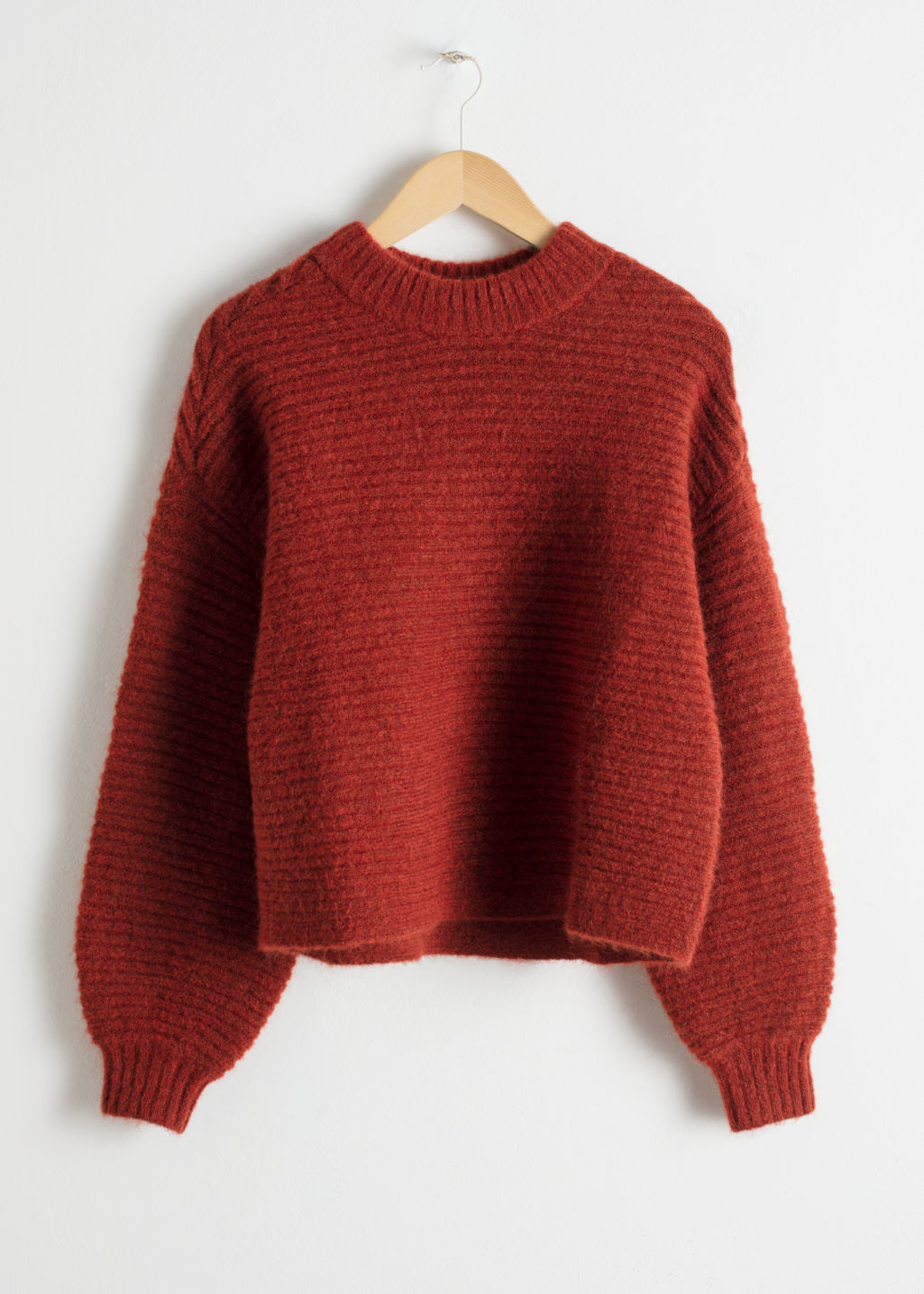 Front image of Stories cropped mock neck sweater in orange