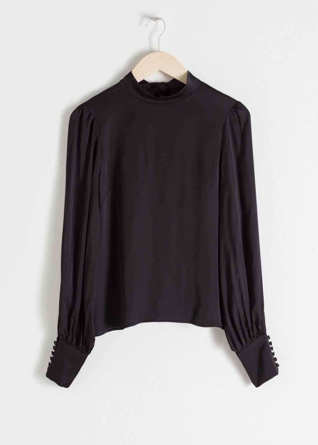 Front image of Stories satin back tie blouse in black