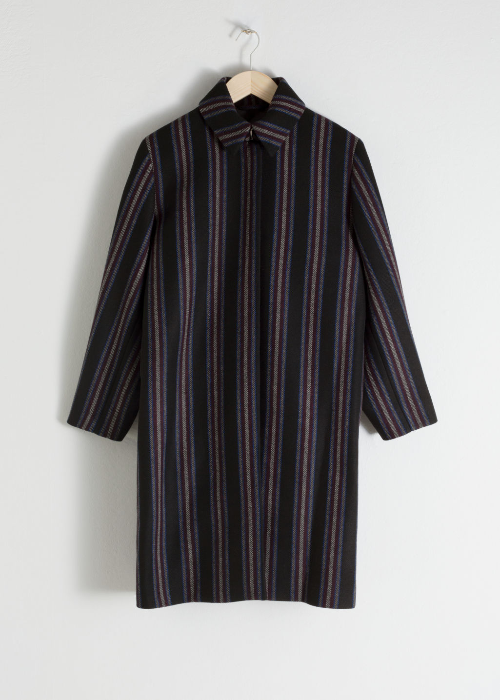 Front image of Stories wool blend striped coat in black