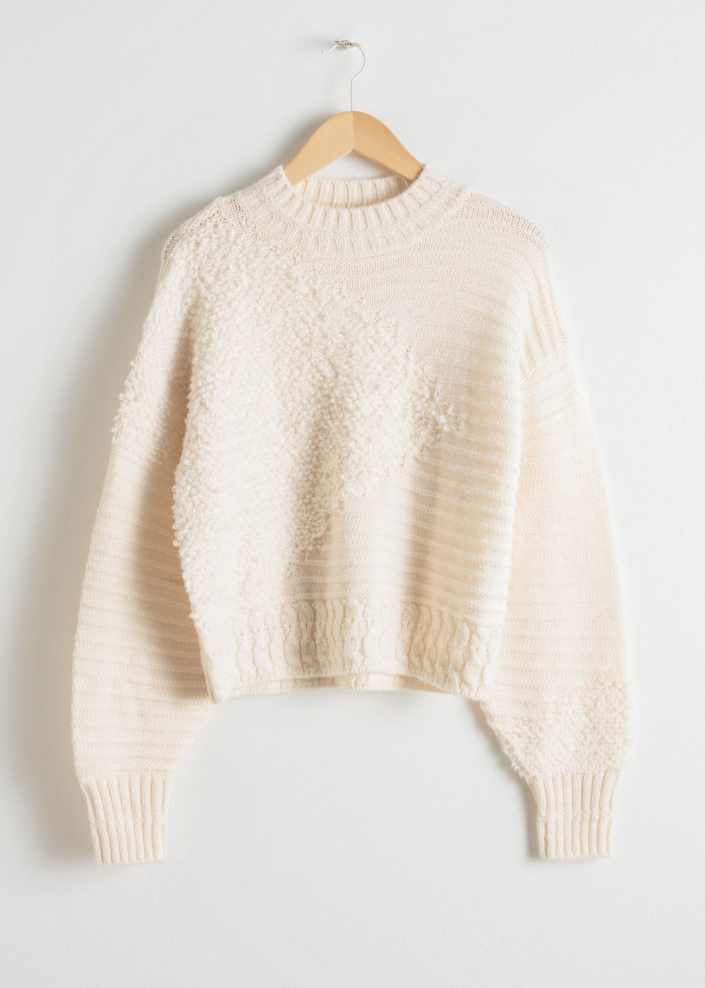 Front image of Stories mixed texture wool sweater in white