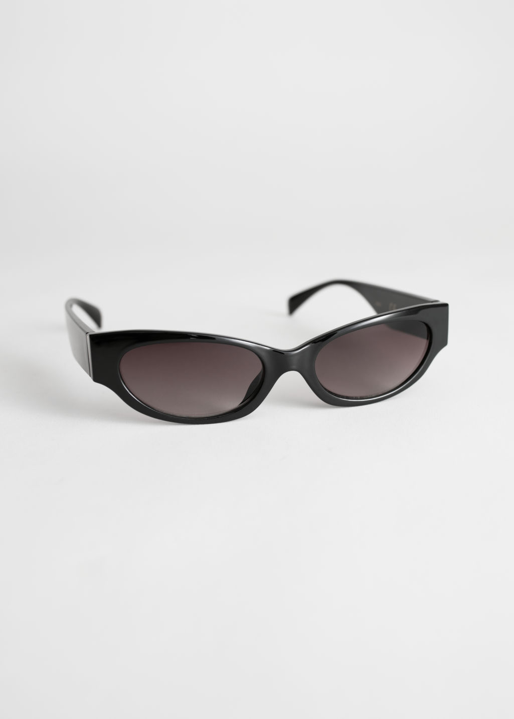 StillLife Front Image of Stories Slim Oval Sunglasses in Black