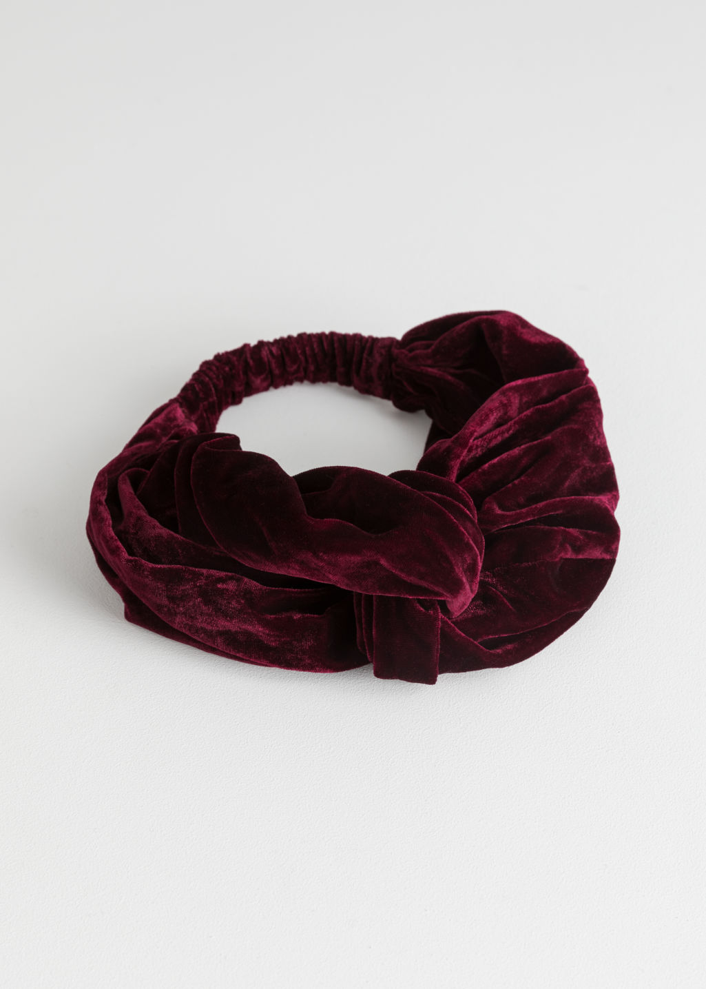 Front image of Stories velvet twist knot hairband in red