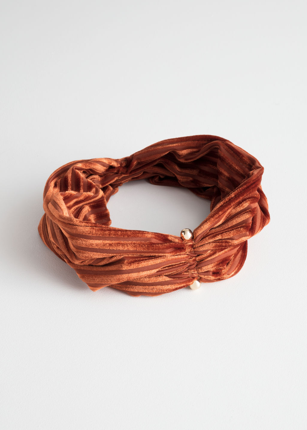 Front image of Stories velvet striped hairband in orange