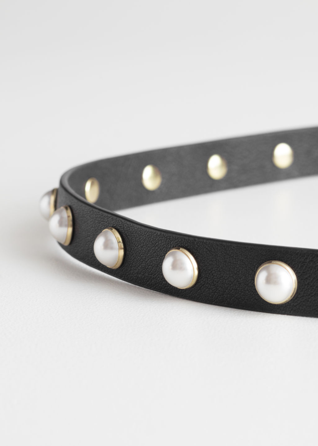 Back image of Stories pearl buckle leather belt in black