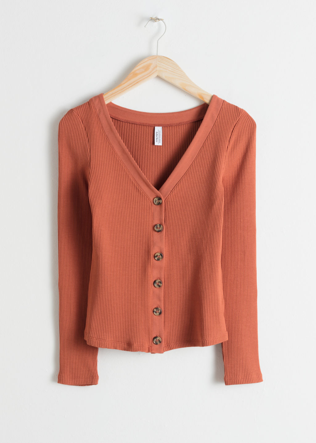 Front image of Stories fitted ribbed cardigan in orange