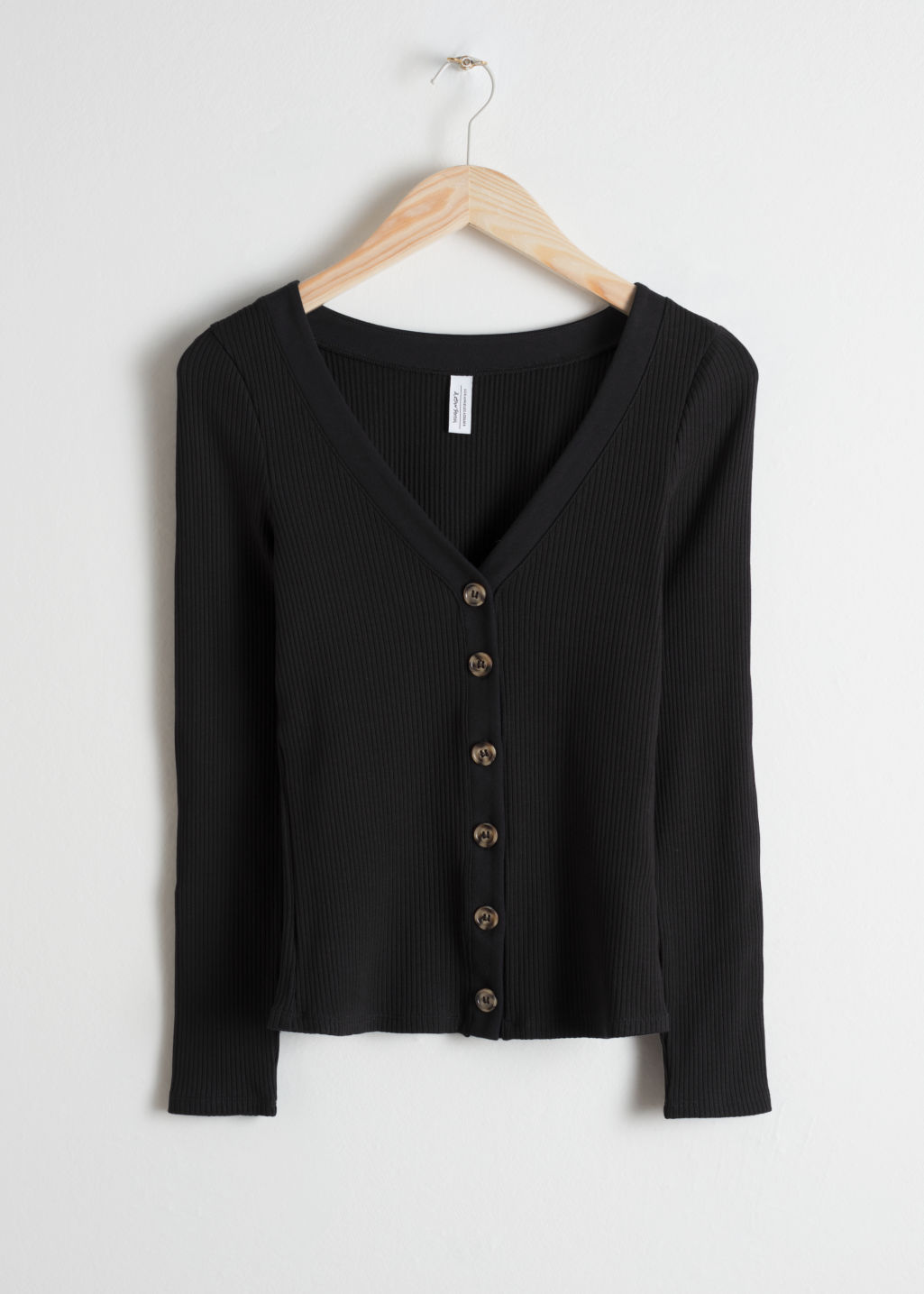 Front image of Stories fitted ribbed cardigan in black