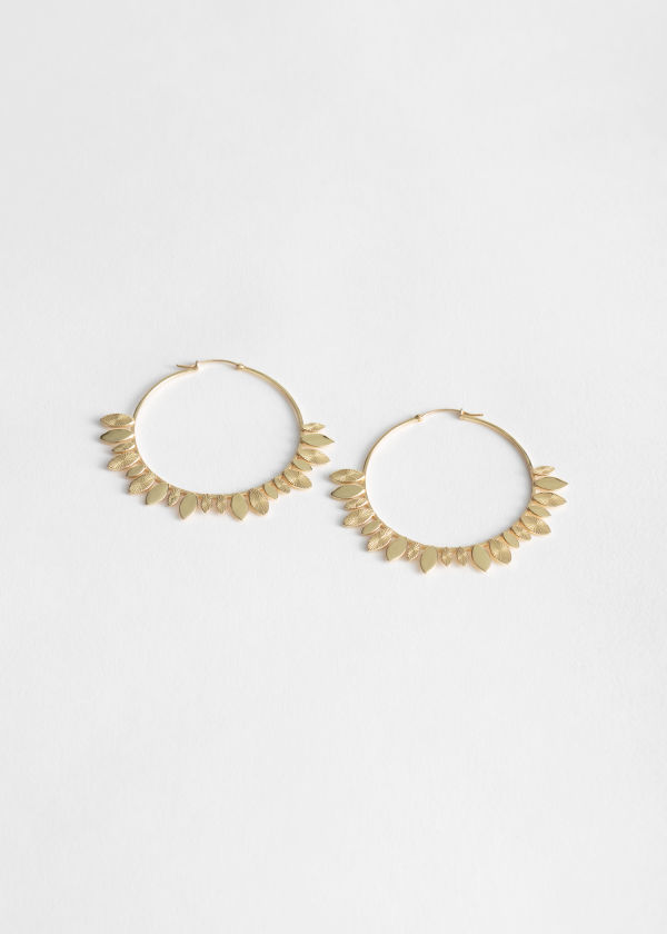 Front image of Stories leaf charm hoop earrings in gold