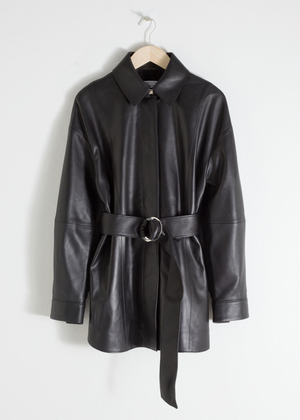 Front image of Stories oversized belted leather jacket in black