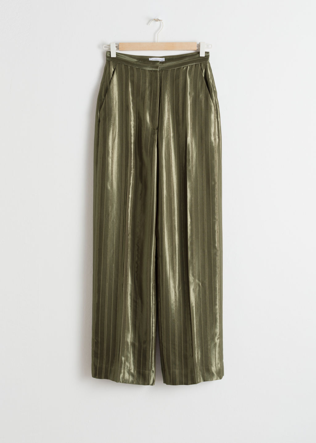Front image of Stories tailored jacquard stripe trousers in green