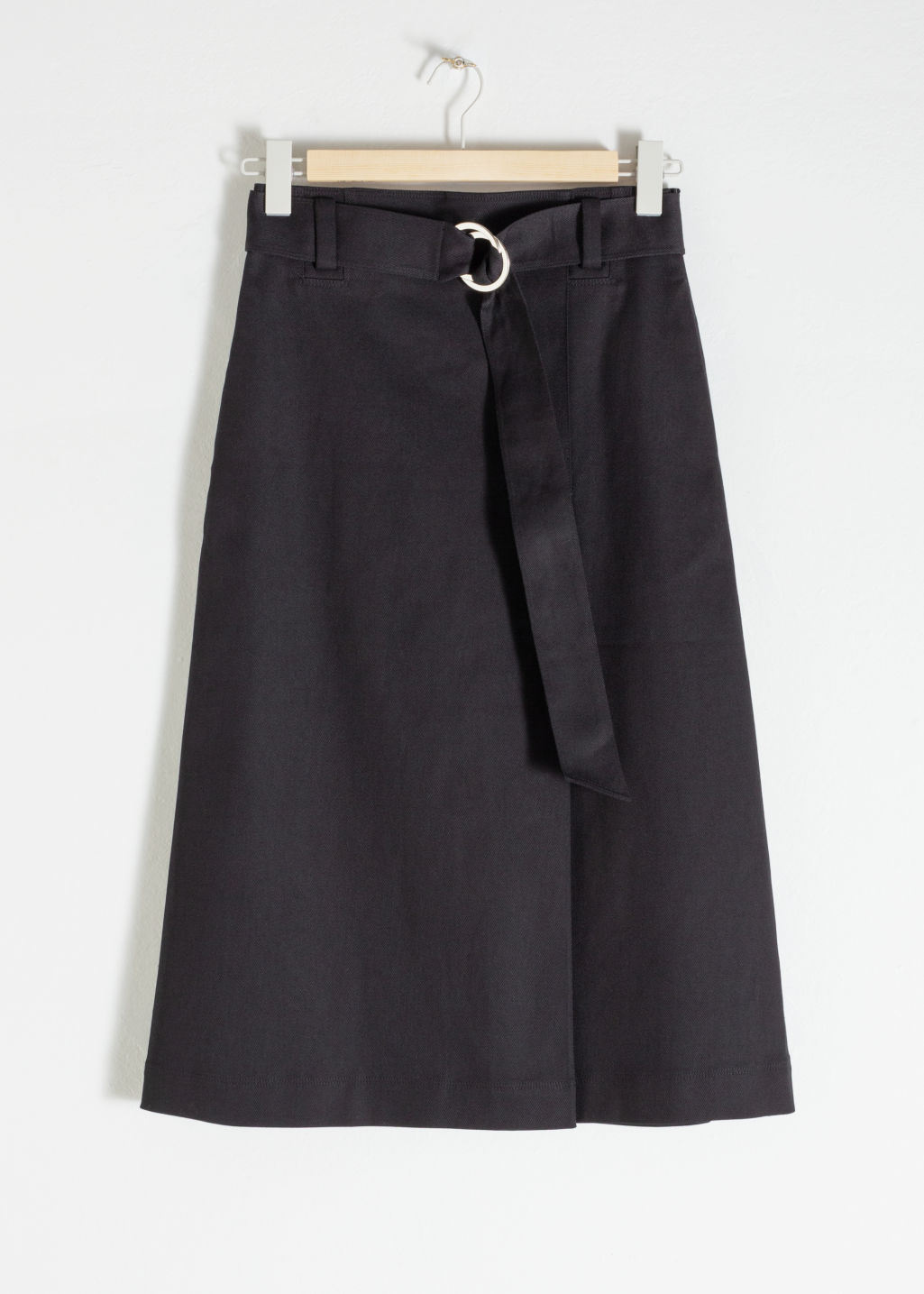 Front image of Stories belted a-line midi skirt in black