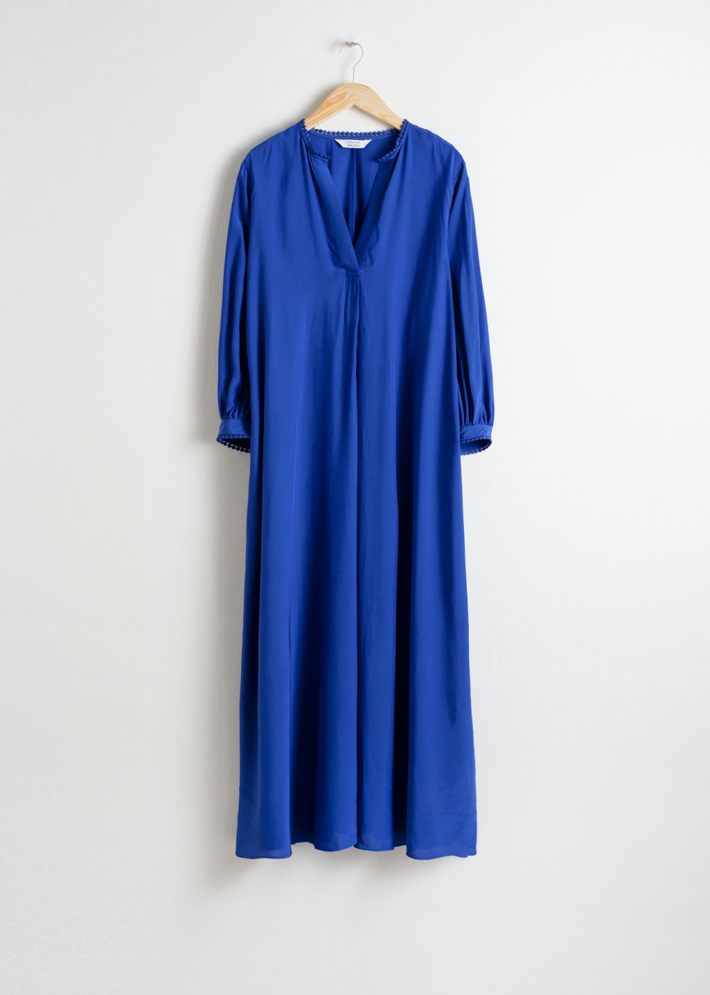 Front image of Stories v-neck kaftan maxi dress in blue