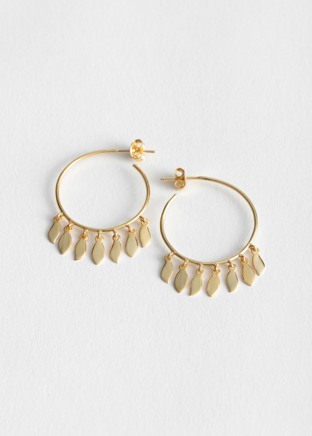 Front image of Stories open leaf charm hoops in gold