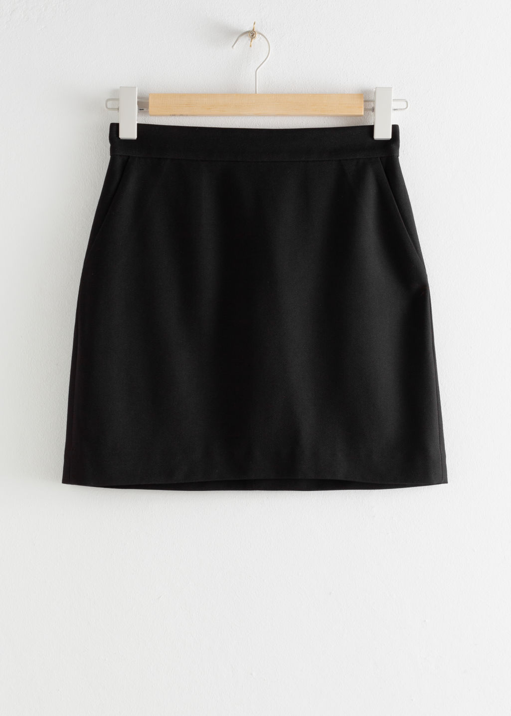 Front image of Stories velvet mini pencil skirt in black