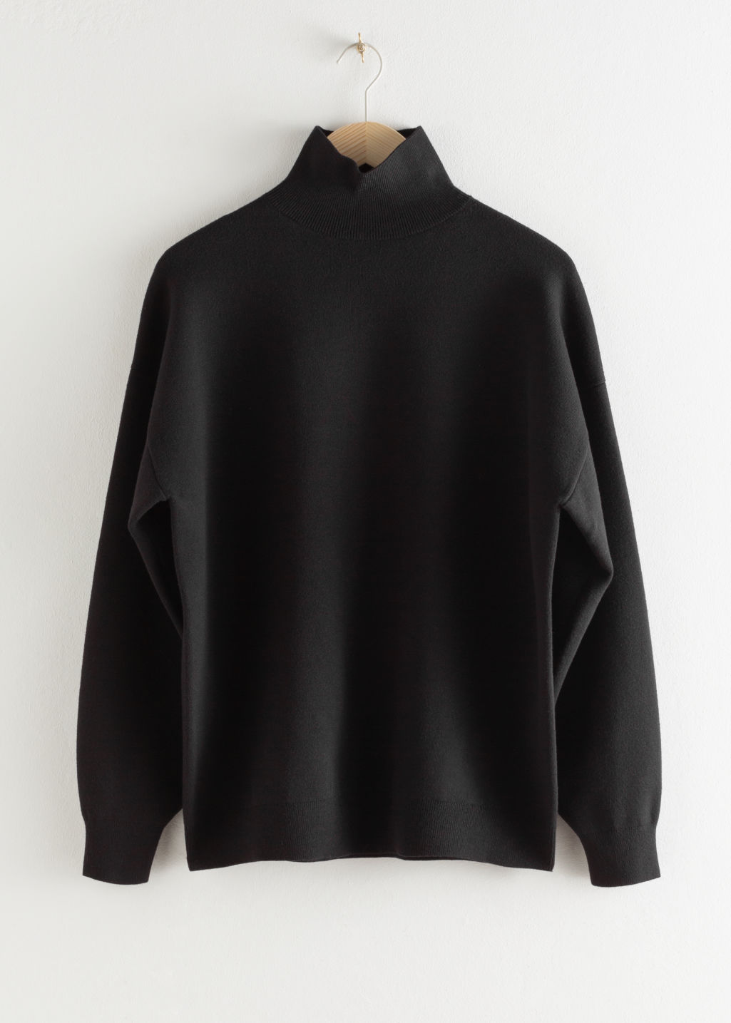 StillLife Front Image of Stories Oversized Micro Knit Turtleneck in Black