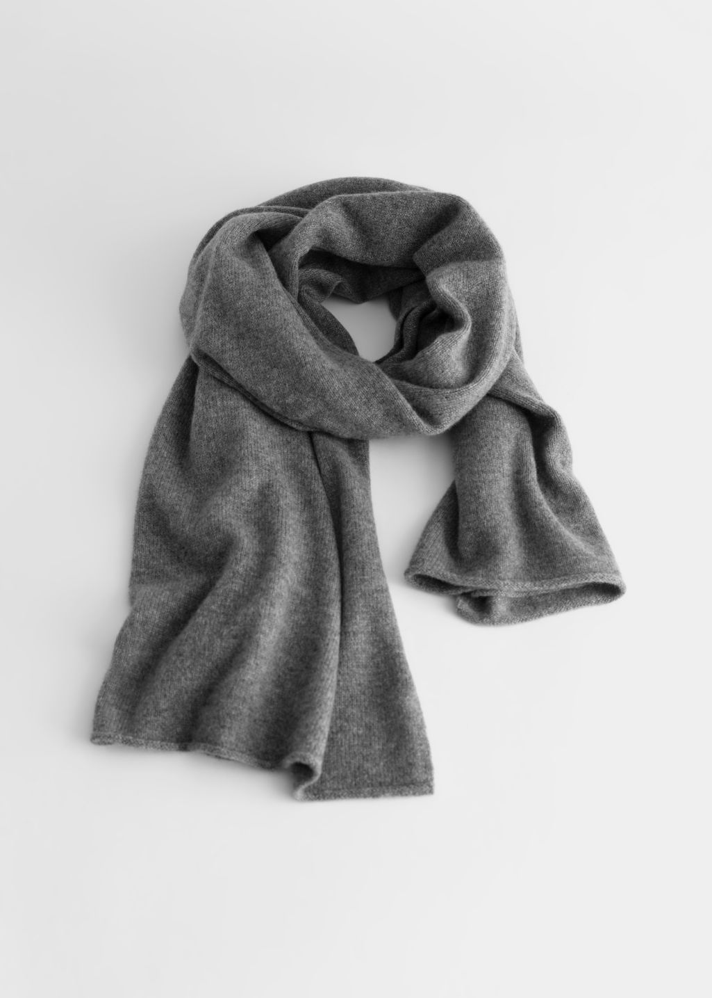 Front image of Stories soft knit scarf in grey
