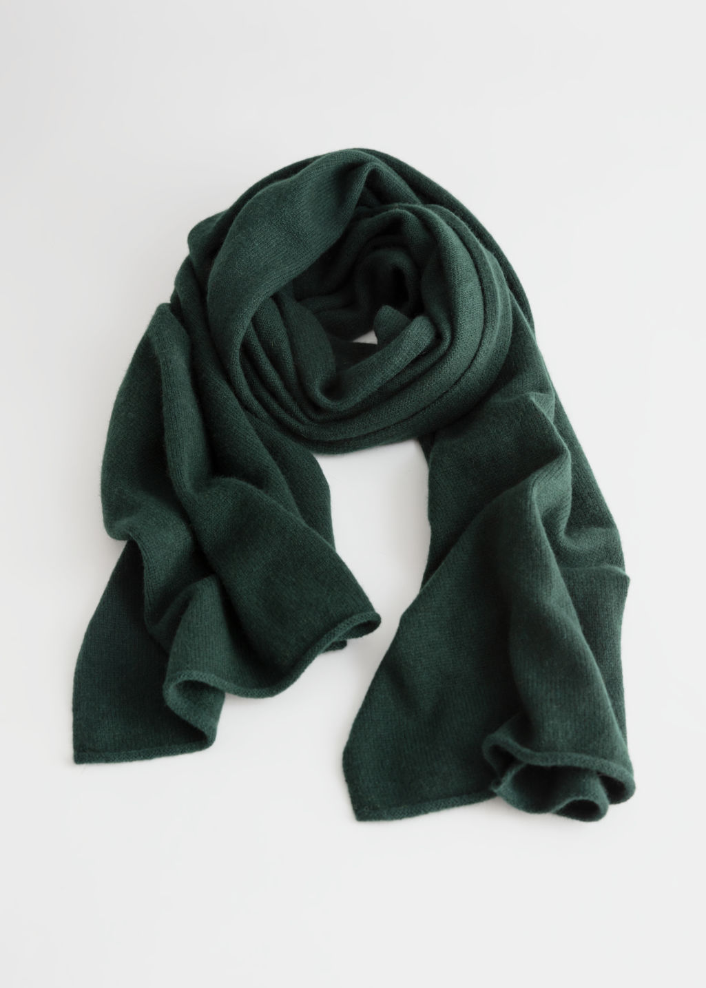 Front image of Stories soft knit scarf in green