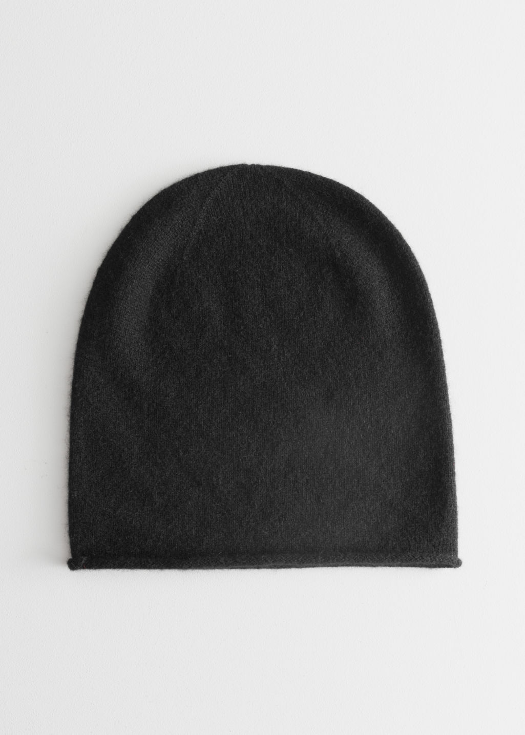 Front image of Stories cashmere knit beanie in black