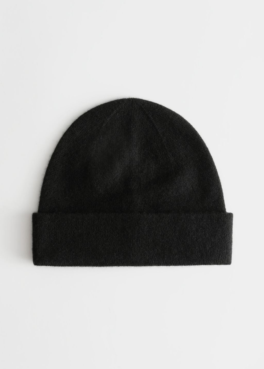 Front image of Stories soft knit beanie in black