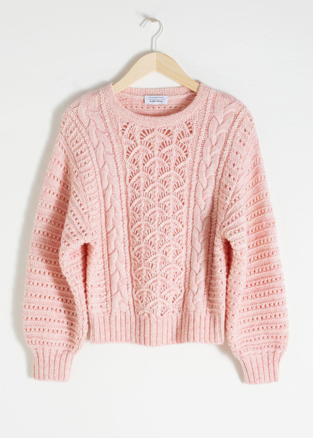 Front image of Stories wool blend cable knit sweater in pink