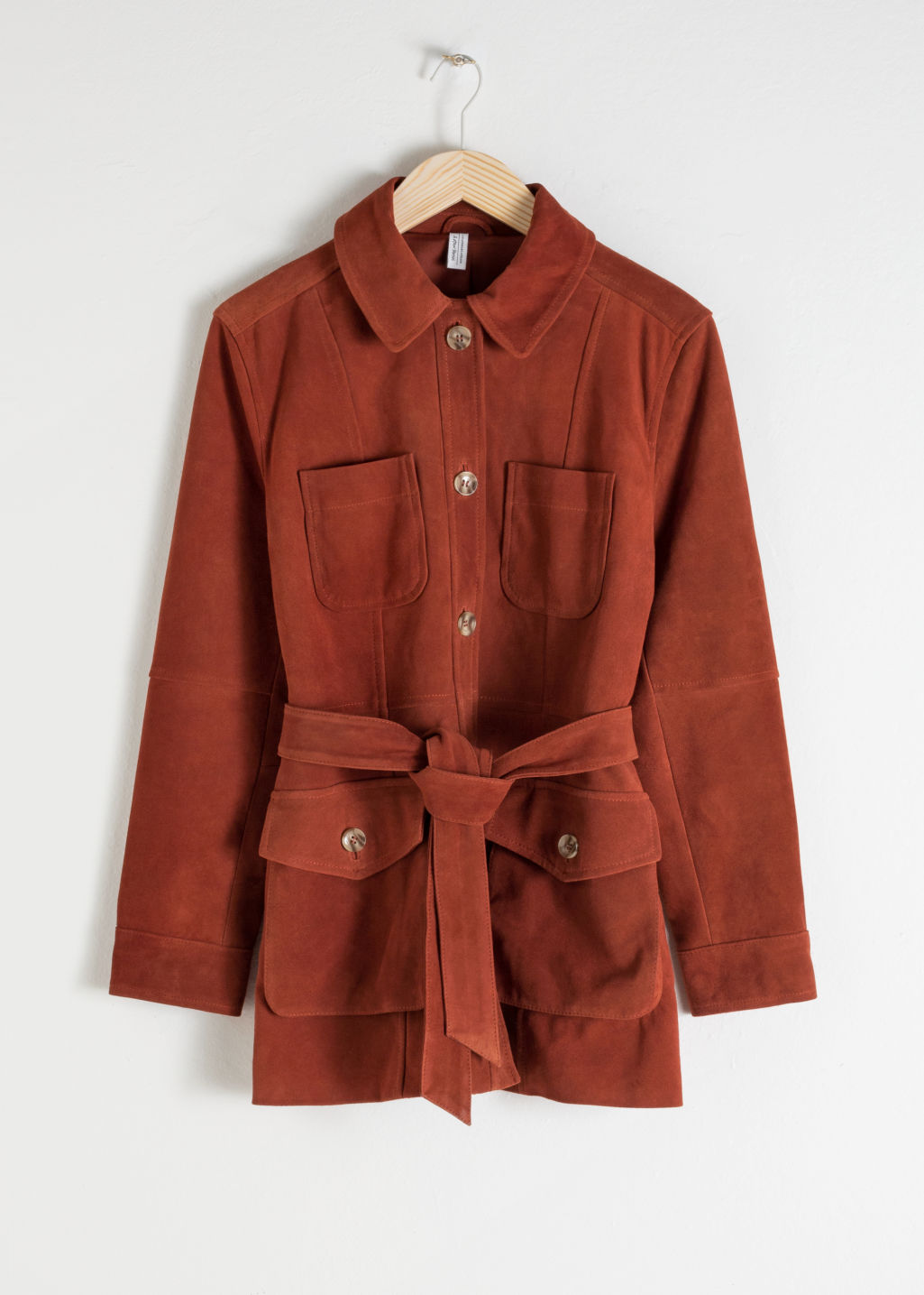 Front image of Stories belted suede workwear jacket in orange
