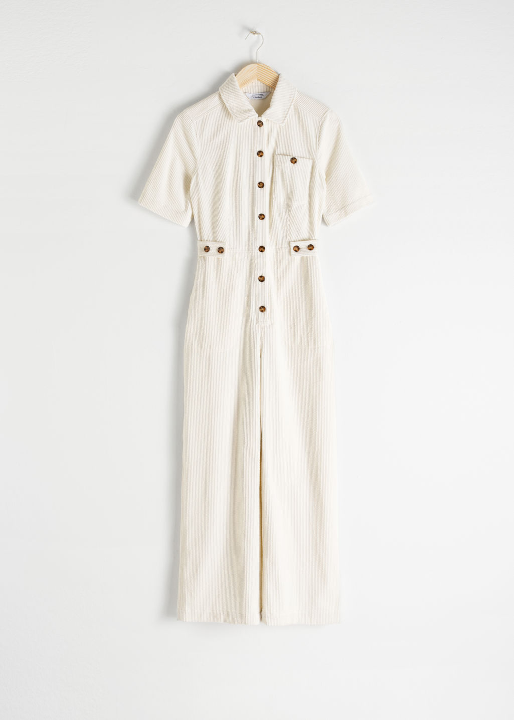 Front image of Stories corduroy boilersuit in white