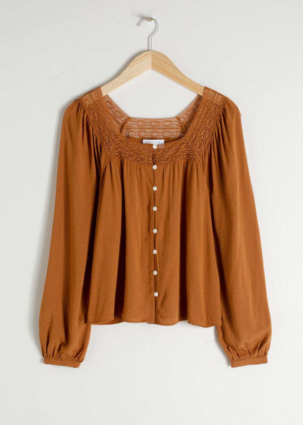 Front image of Stories cropped lace trim peasant blouse in orange