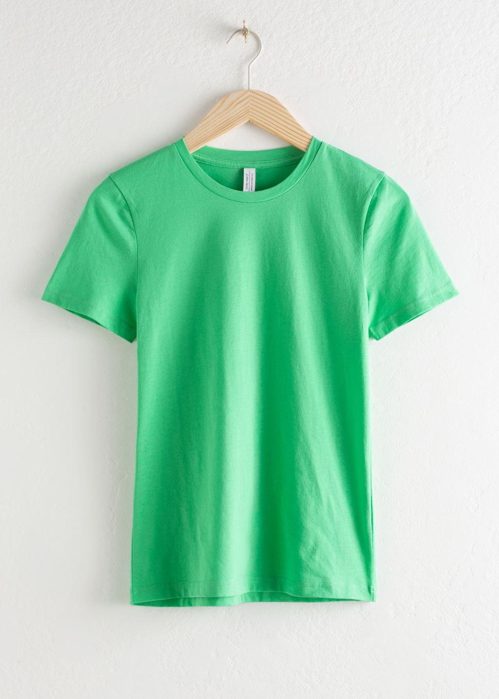 Front image of Stories organic cotton zebra t-shirt in green