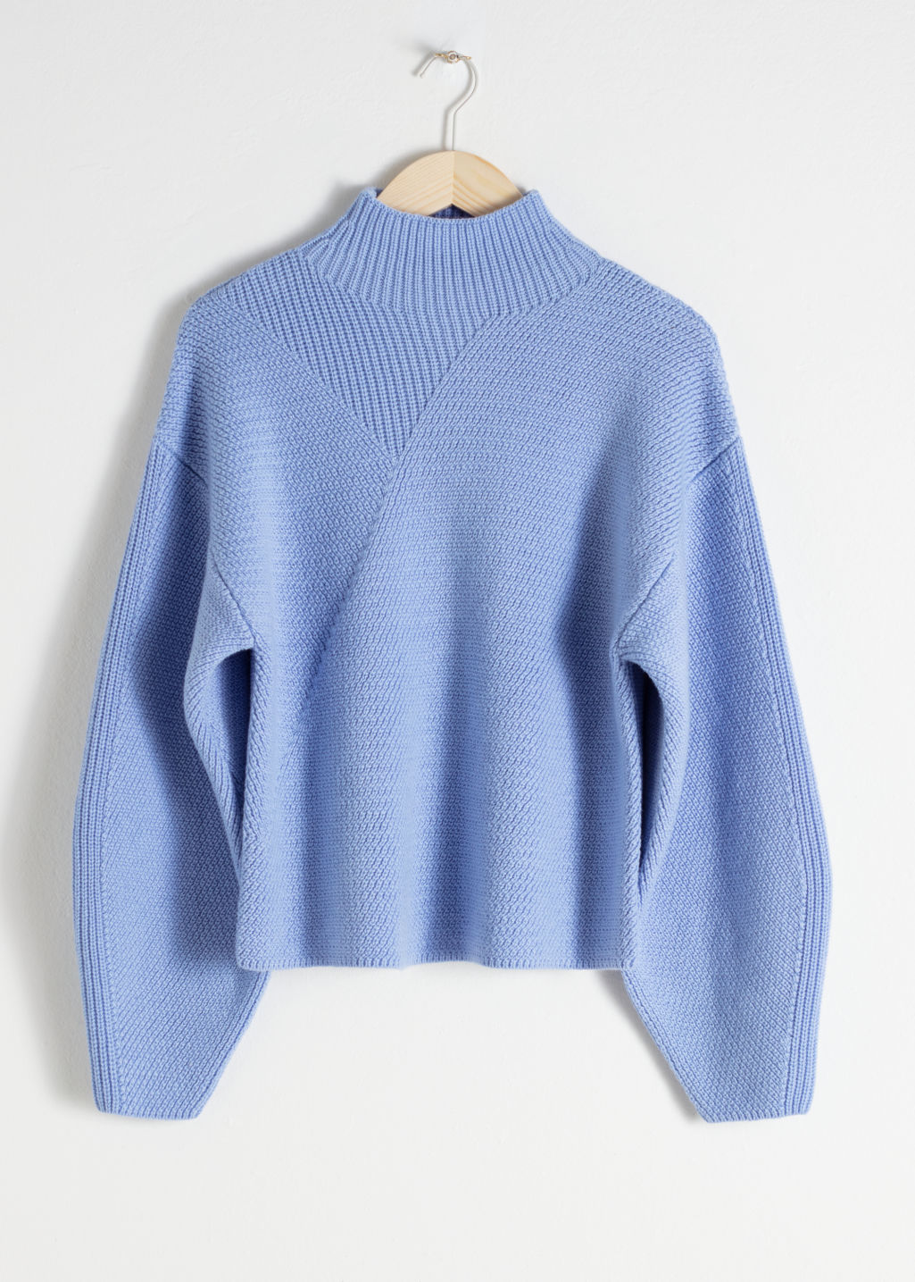 Front image of Stories wool blend mock neck sweater in blue