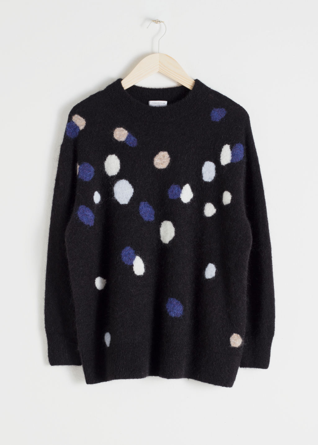 Front image of Stories oversized dotted sweater in black