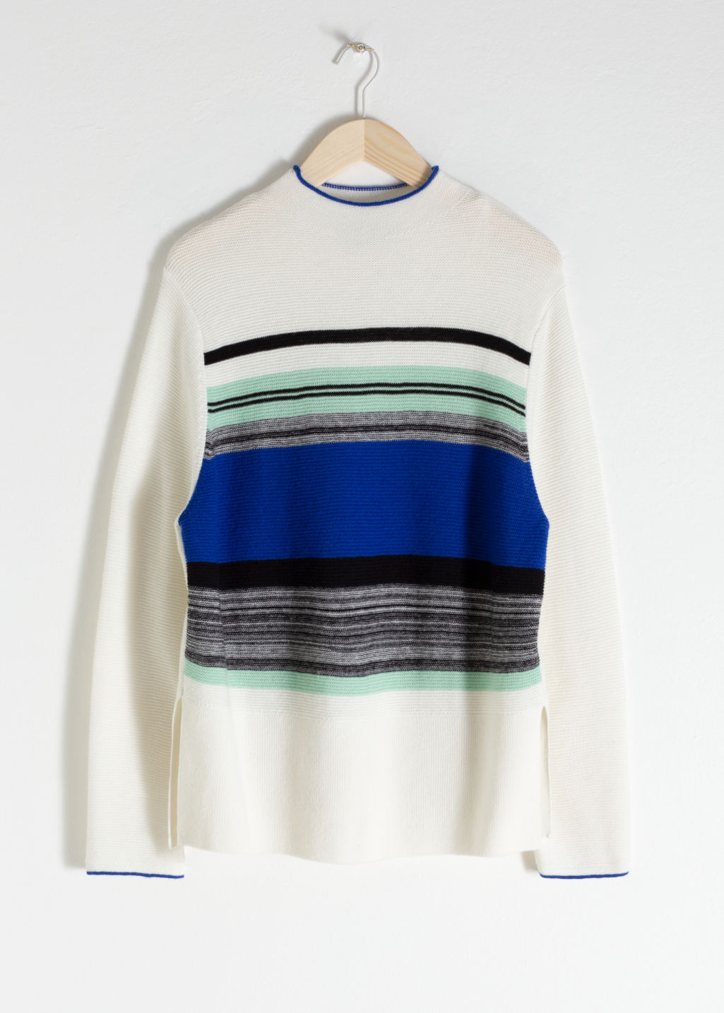 Front image of Stories oversized striped wool blend sweater in white