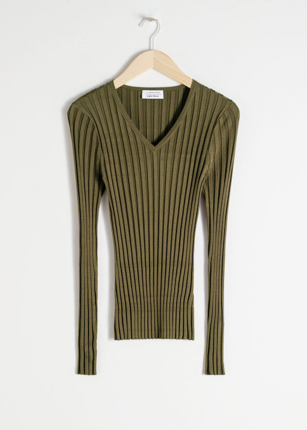 Front image of Stories fitted v-neck ribbed top in green