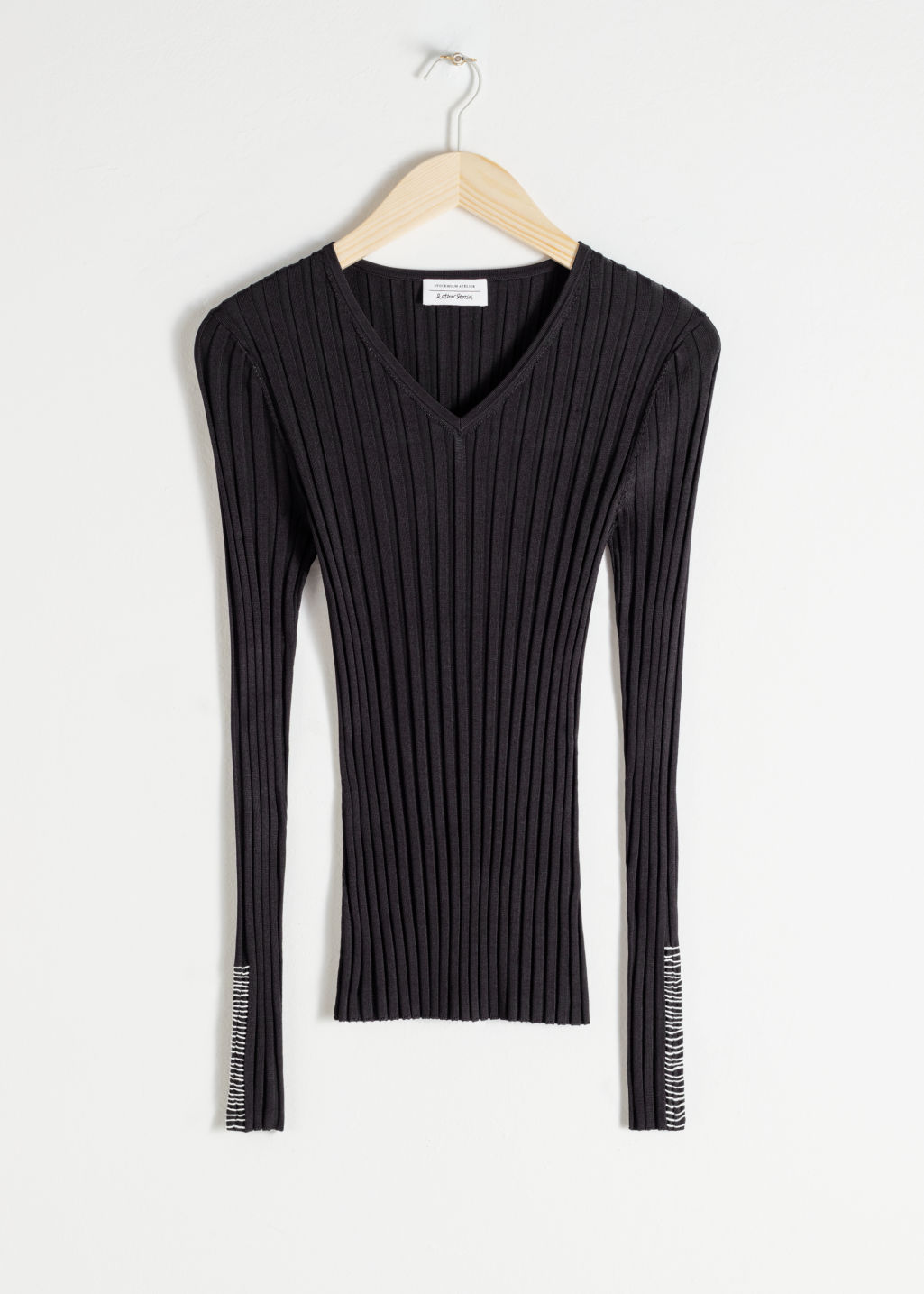 Front image of Stories fitted v-neck ribbed top in black