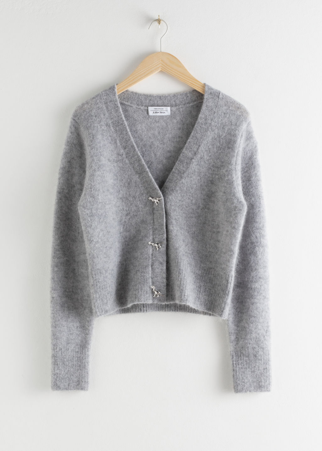 Front image of Stories dinosaur button knit cardigan in grey