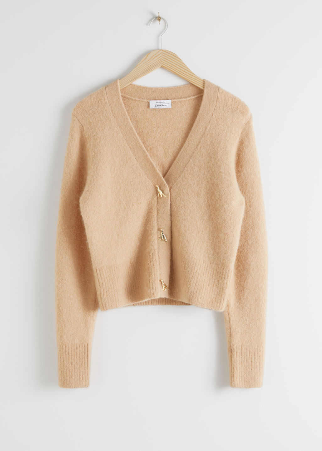 Front image of Stories dinosaur button knit cardigan in beige