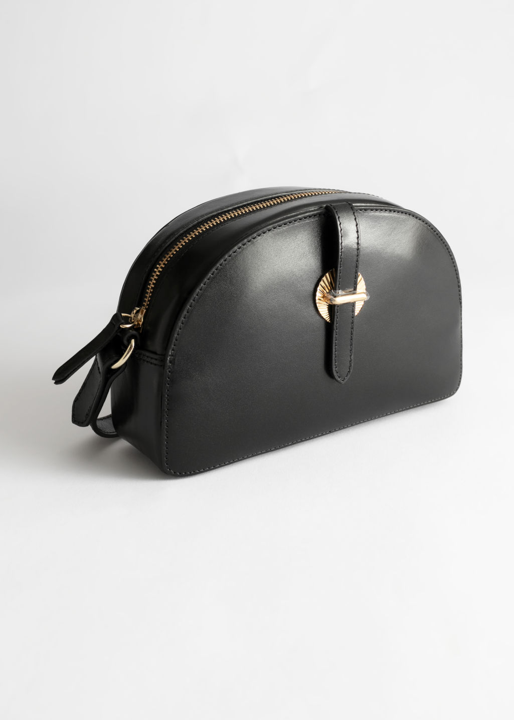 Front image of Stories leather half moon crossbody bag in black