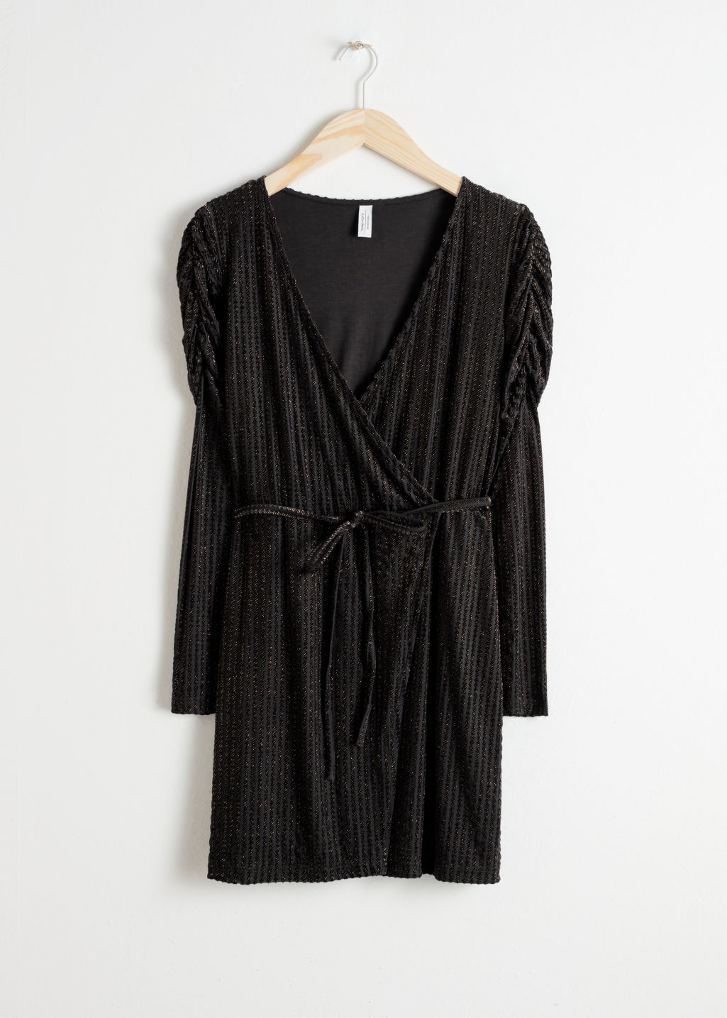 Front image of Stories glitter stripe velvet wrap dress in black