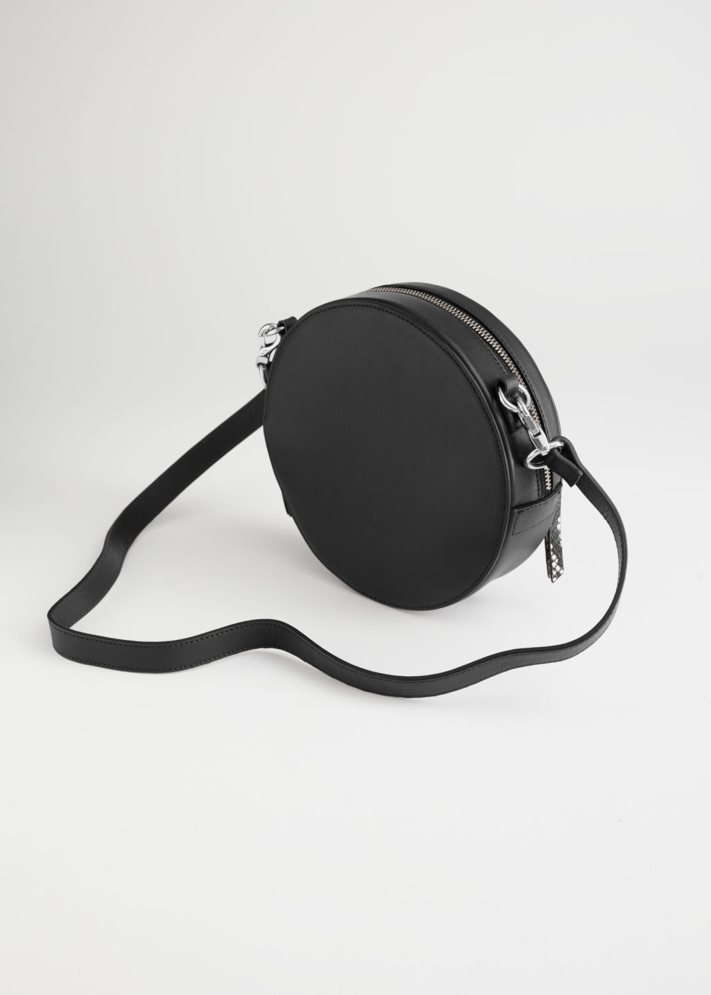 Back image of Stories duo pocket circle crossbody in black