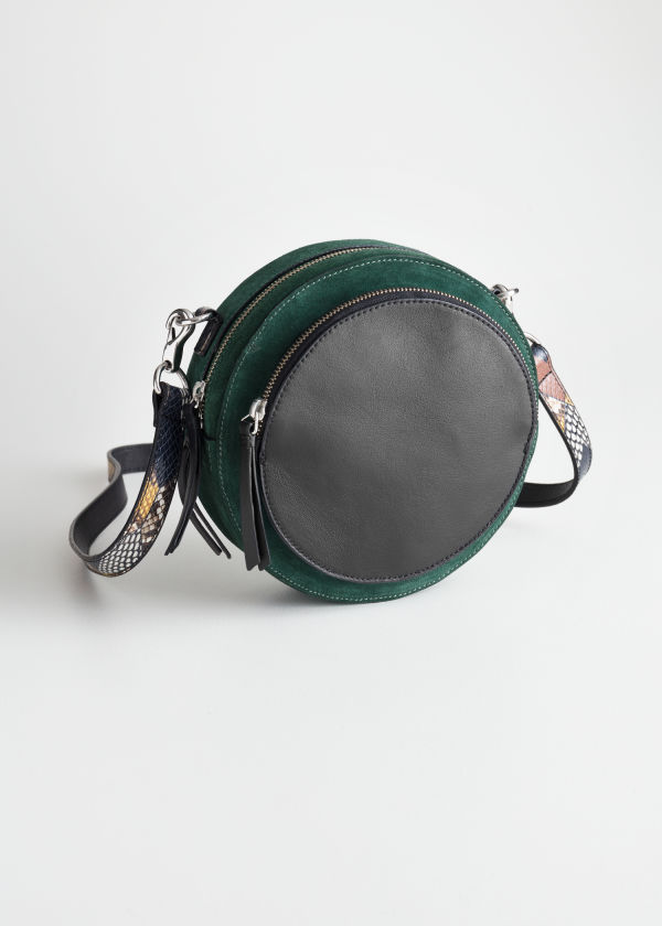 Front image of Stories duo pocket circle crossbody in green