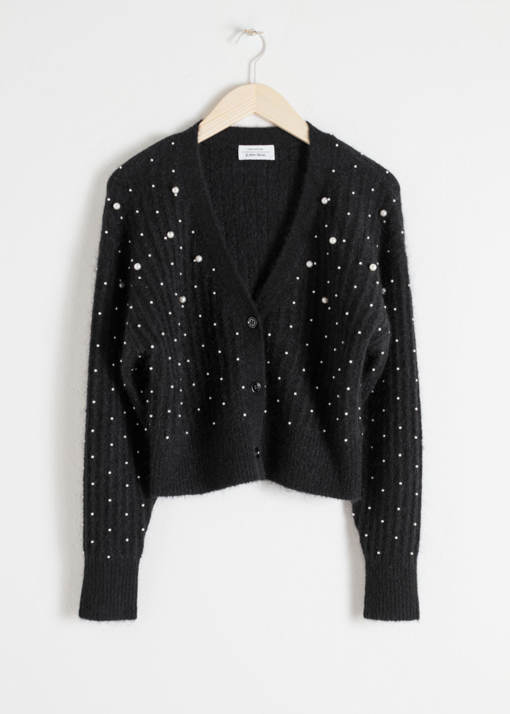 Front image of Stories wool blend pearl cardigan in black