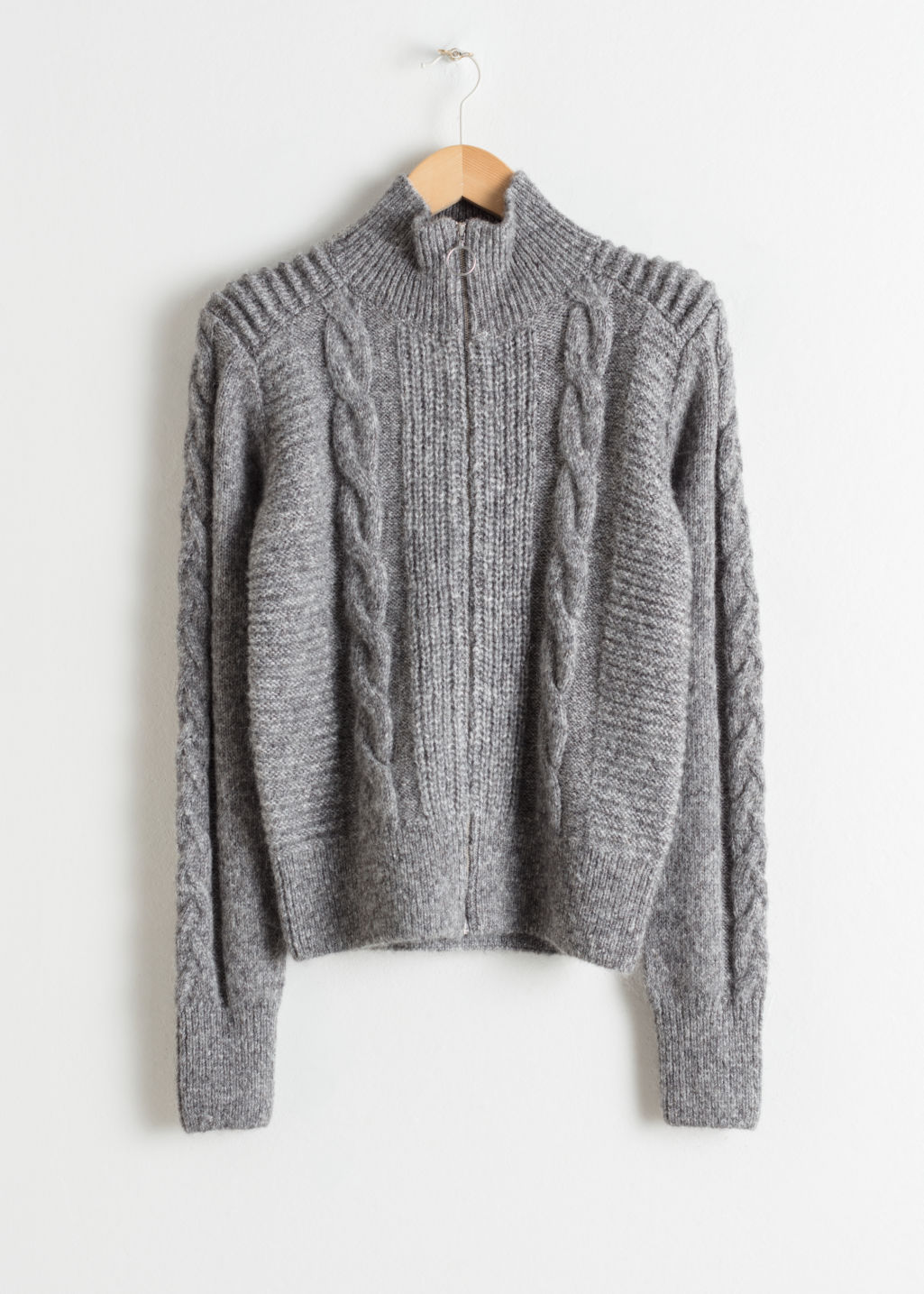 Front image of Stories zip up cable knit cardigan in grey