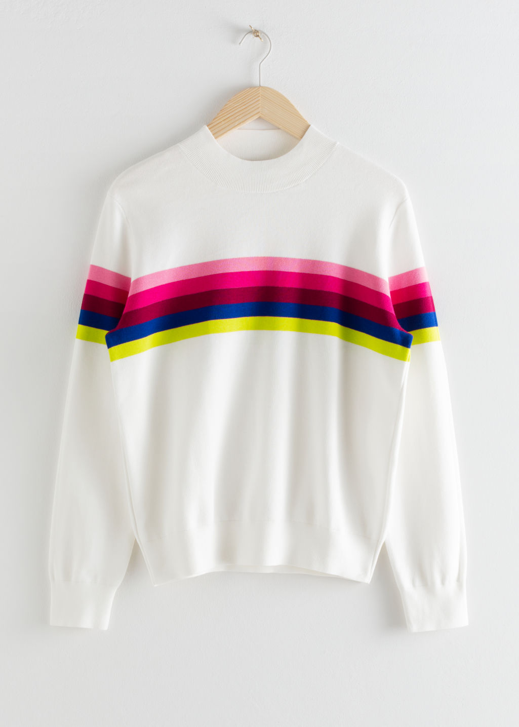 Front image of Stories rainbow stripe pullover in white