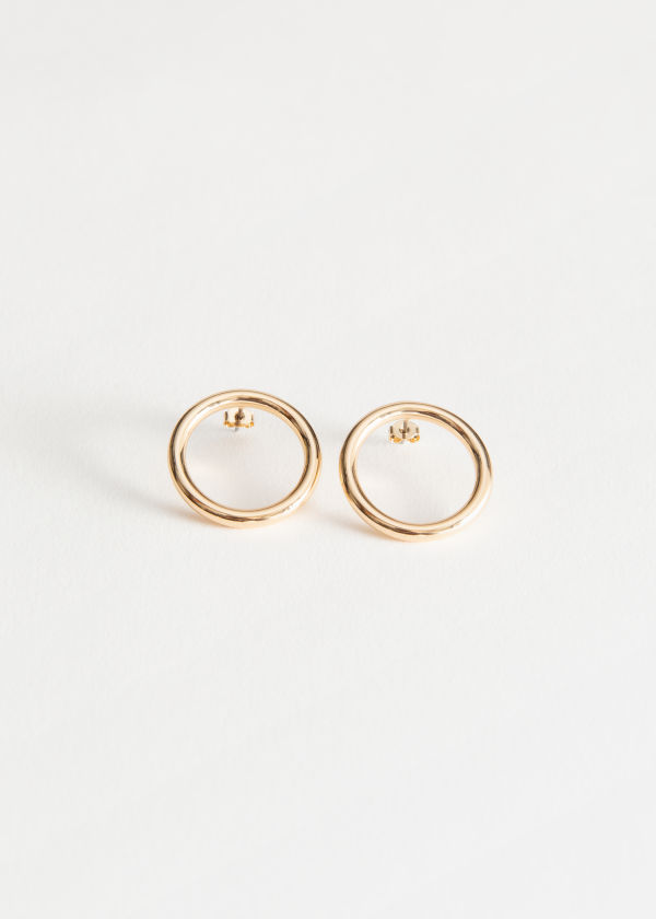Front image of Stories circle earrings in gold