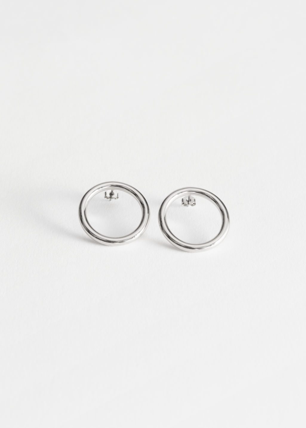 Front image of Stories circle earrings in silver