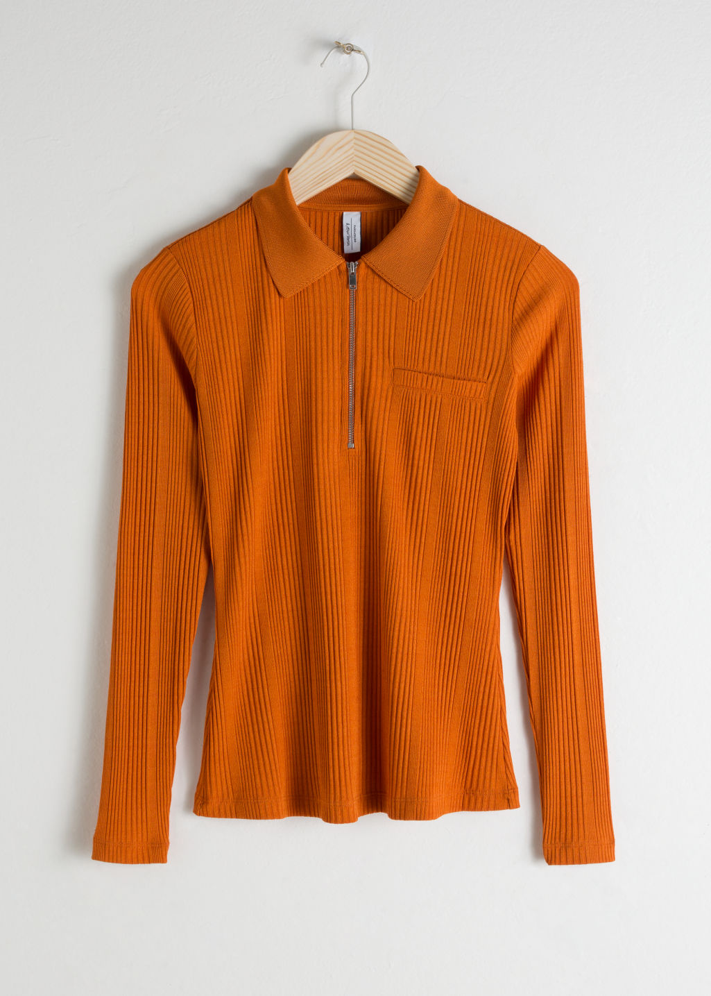 Front image of Stories rib knit zippered polo top in orange