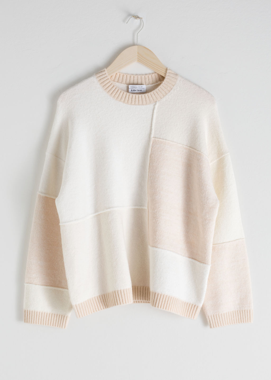 Front image of Stories oversized cotton blend patchwork sweater in white