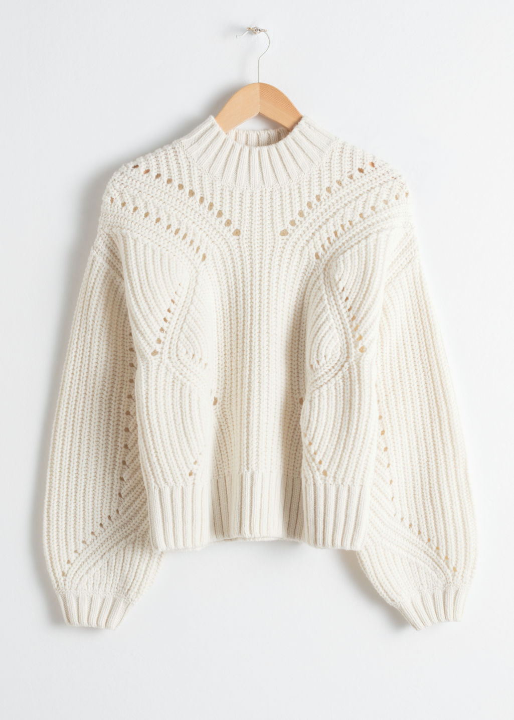 Front image of Stories boxy cable knit sweater in white
