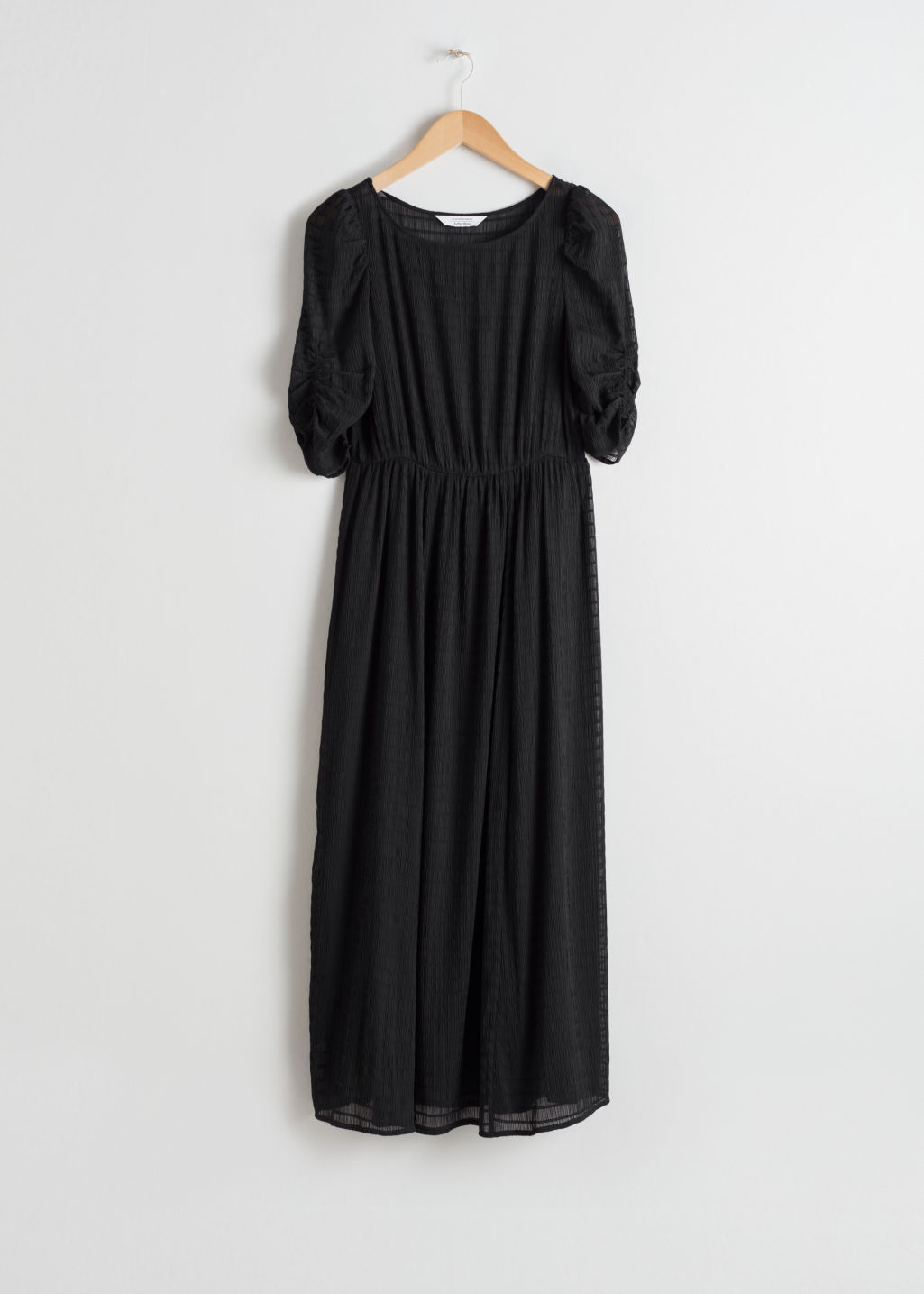 Front image of Stories sheer ruched midi dress in black