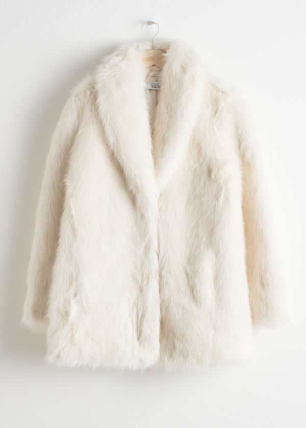 Front image of Stories faux fur coat in white