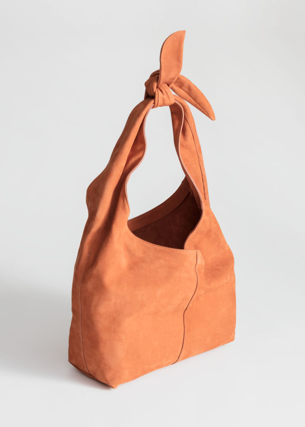 Front image of Stories soft suede tie up bag in yellow